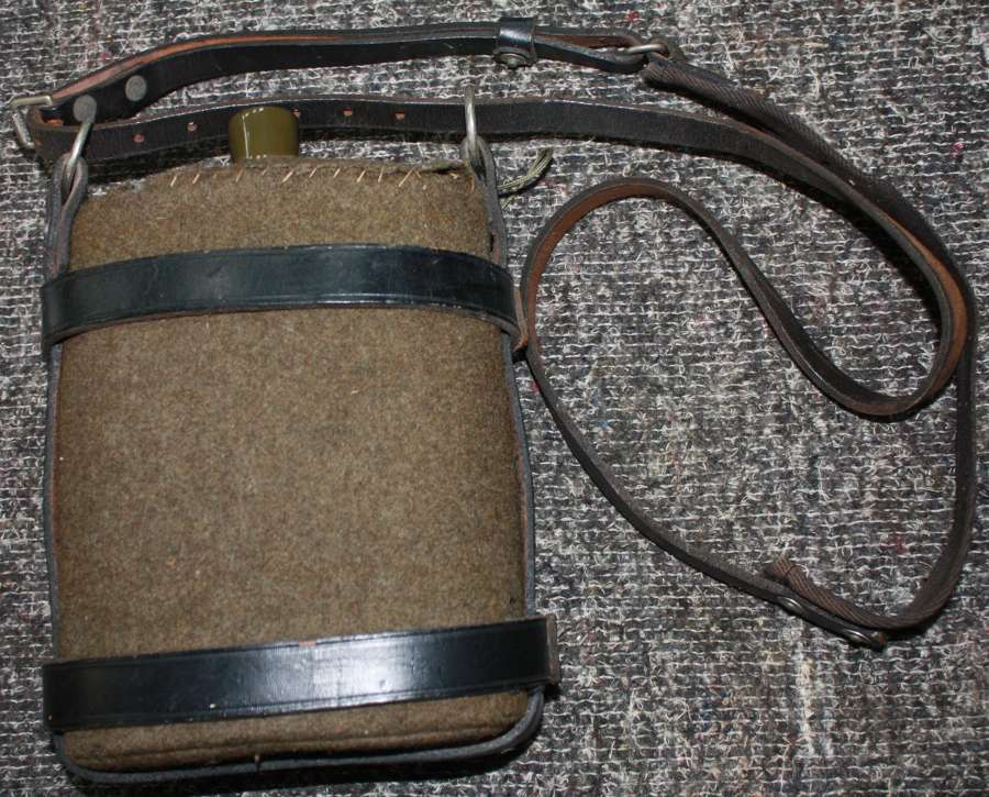 A WWII ARP WATER BOTTLE CRADLE WITH A WATER BOTTLE