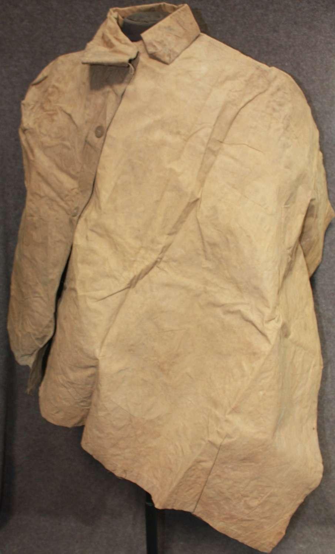A 1944 DATED TAN RAIN CAPE / GROUND SHEET