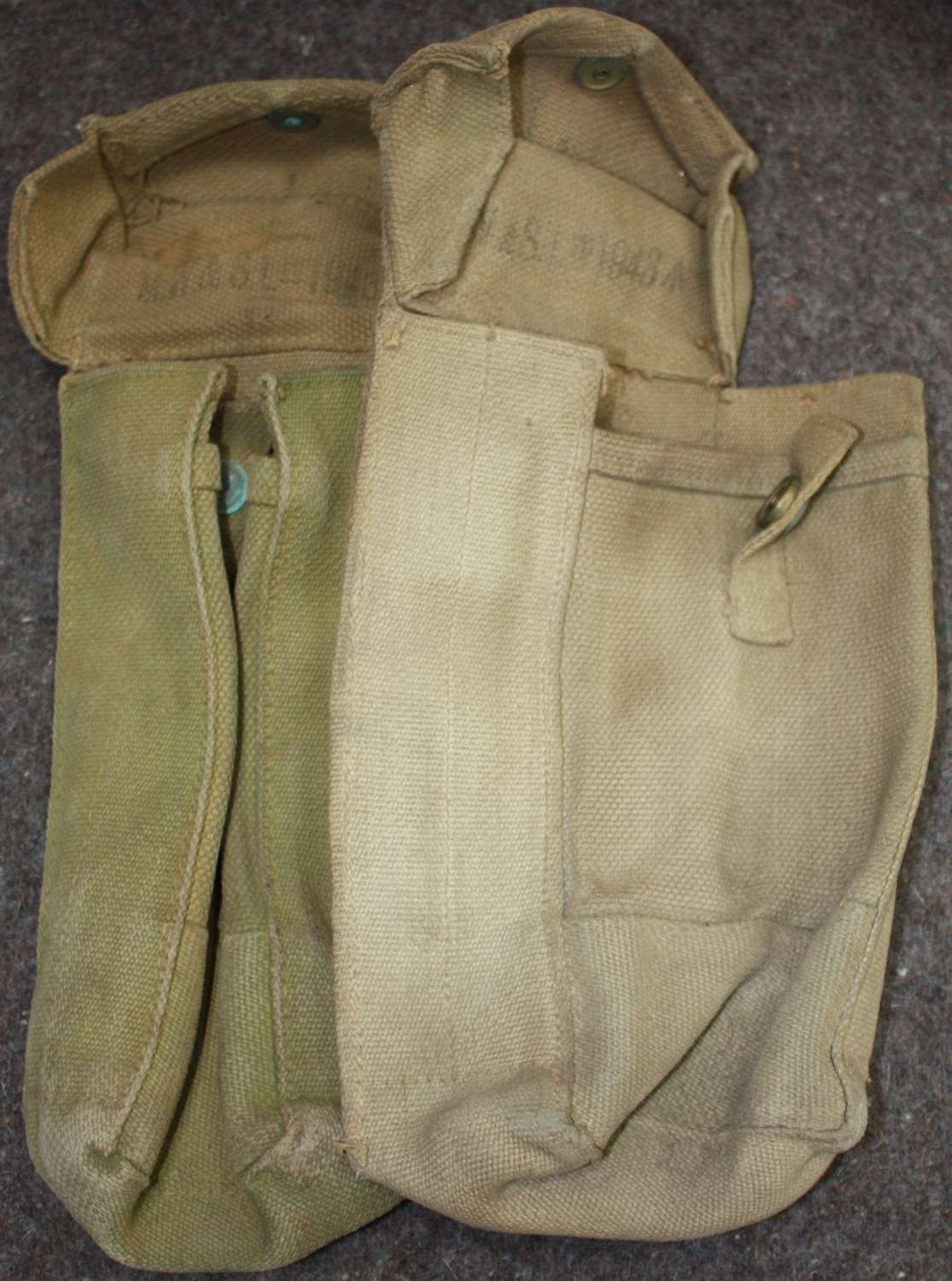 A PAIR OF MAKER MATCHING 1943 DATED 27 PATTERN AMMO POUCHES
