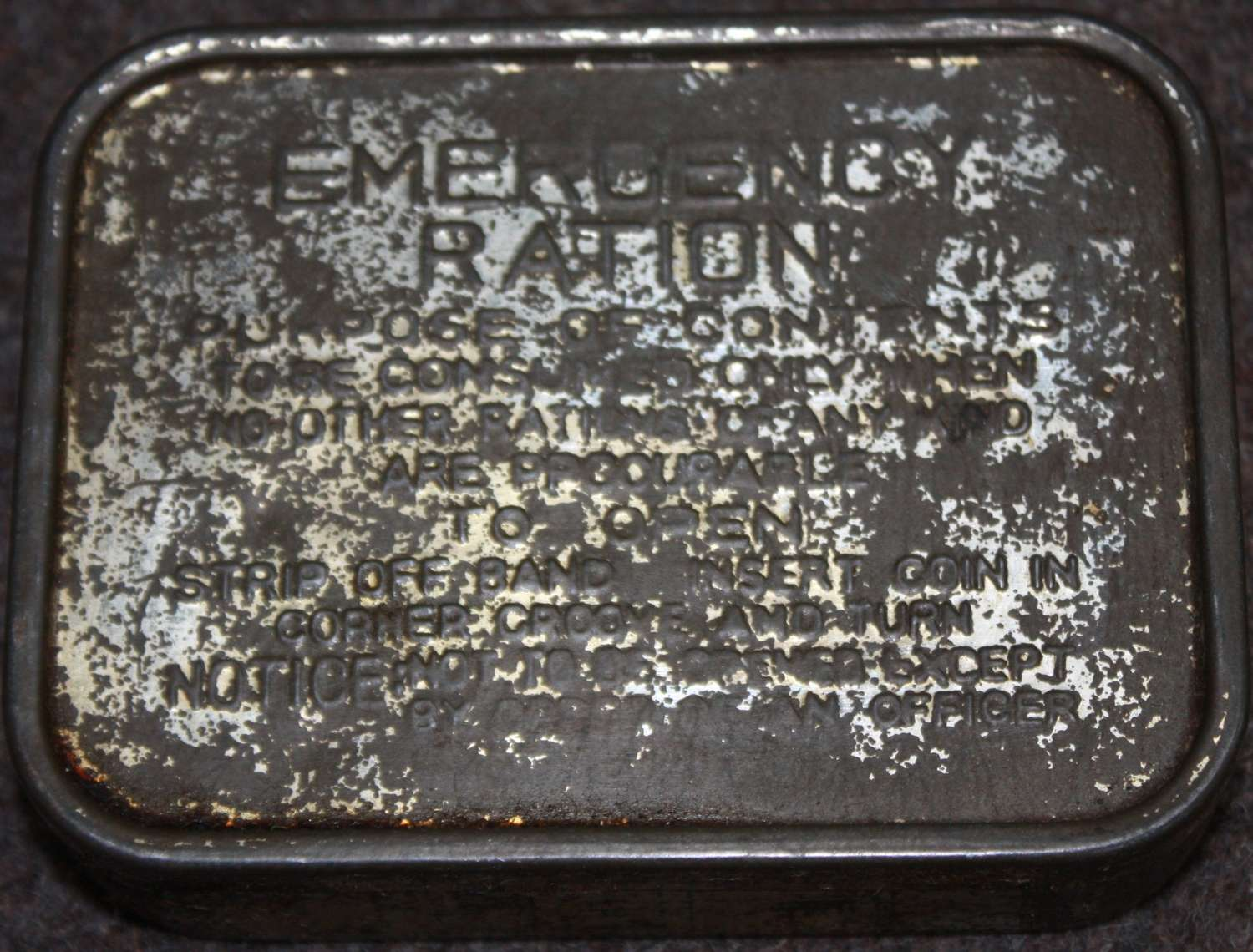 A WELL USED EXAMPLE OF THE WWII EMERGENCY RATION TIN