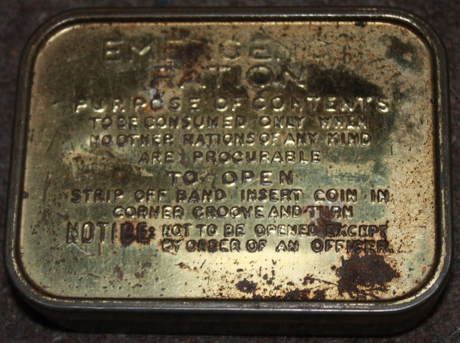 A GOOD USED WWII EMERGENCY RATION TIN