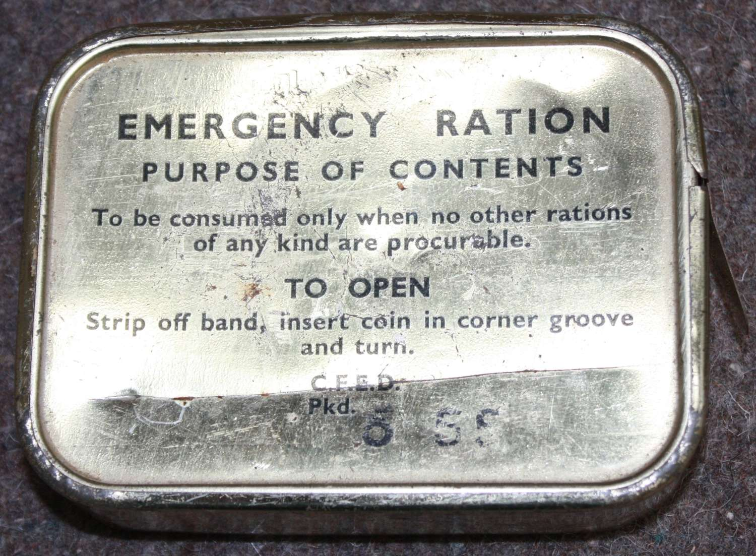 A 1955 DATED EMERGENCY RATION TIN THIS IS FULL