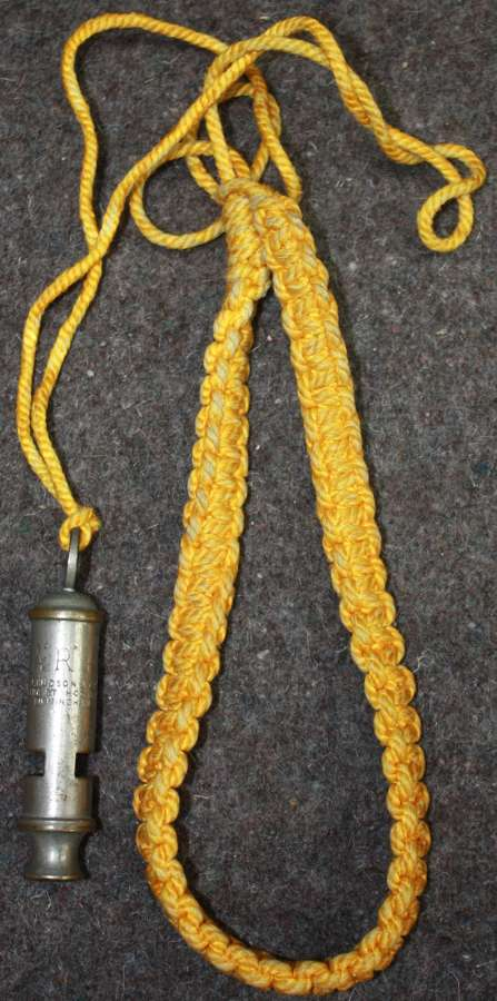 A WWII ARP LANYARD AND WHISTLE