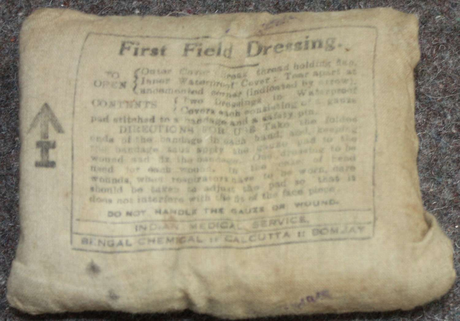 A WWII INDIAN ARMY ISSUE 1ST FIELD DRESSING