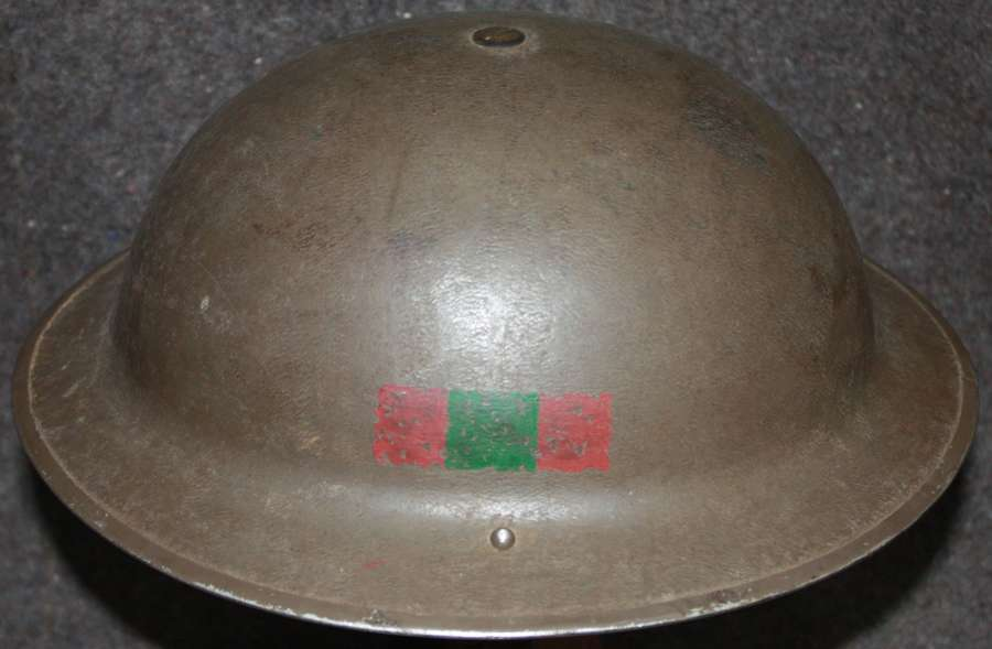 A GOOD EARLY WWII 5TH DEVONSHIRES TOMMY HELMET 1939 DATED