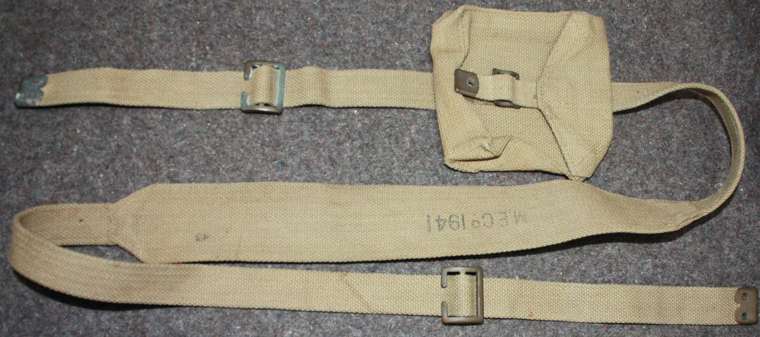 A 1941 DATED FLARE CARTRIDGE TIN SHOULDER STRAP