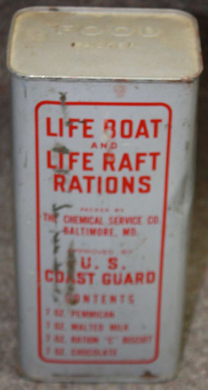 A UNOPENED 1945 DATED US COST GUARD LARGE SIZE LIFE RAFT RATION TIN
