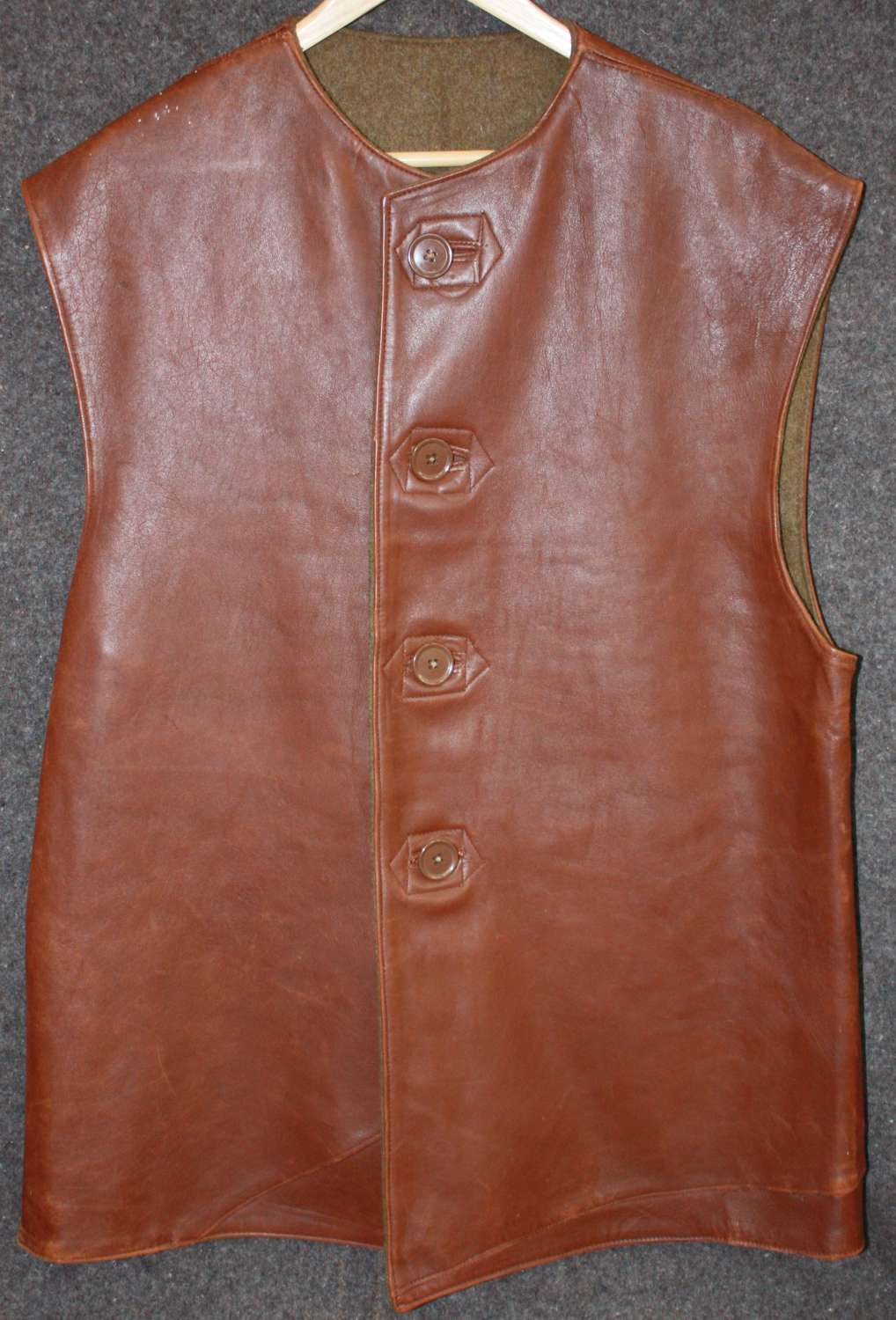 A GOOD BRITISH WWII LEATHER JERKIN SIZE 2