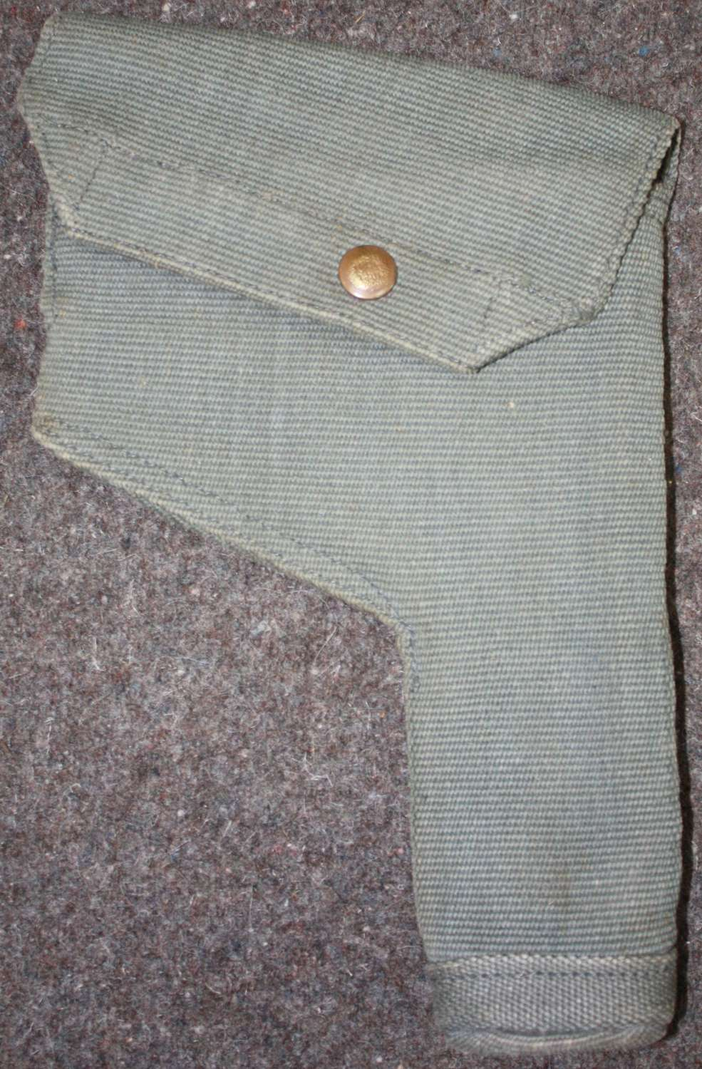 A POST WWII RAF 37 PATTERN PISTOL HOLSTER 1951 DATED