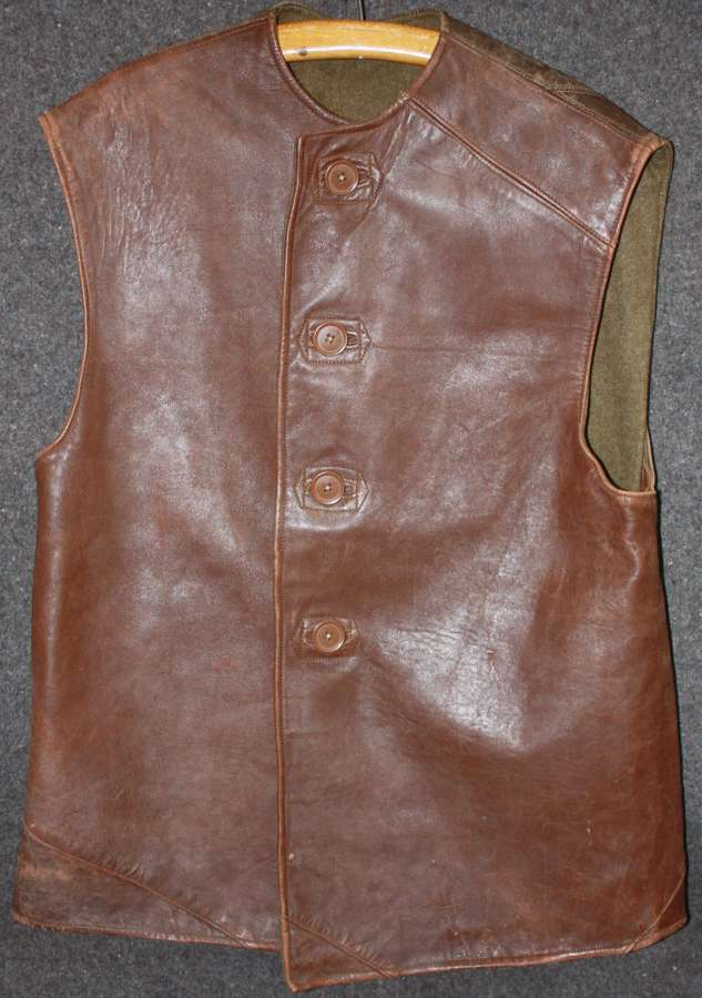 A VERY GOOD WWII 1942 DATED LEATHER JERKIN