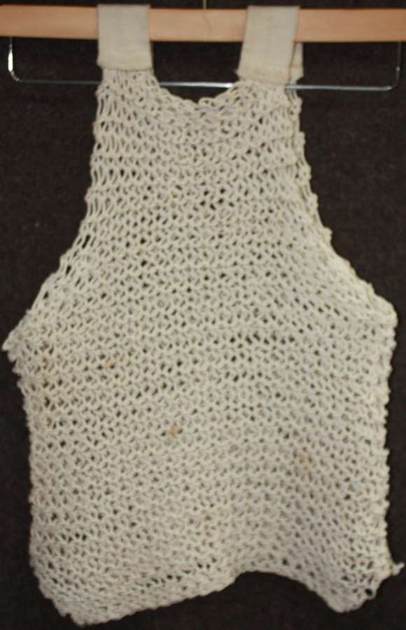 A GOOD BRITISH ISSUE 1945 DATED STRING VEST SIZE 1 EXAMPLE