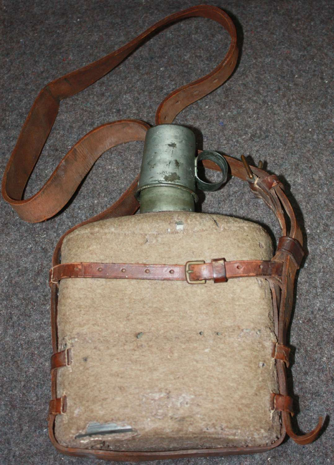 A WWII PERIOD MEDICS WATER BOTTLE AND AM CUP