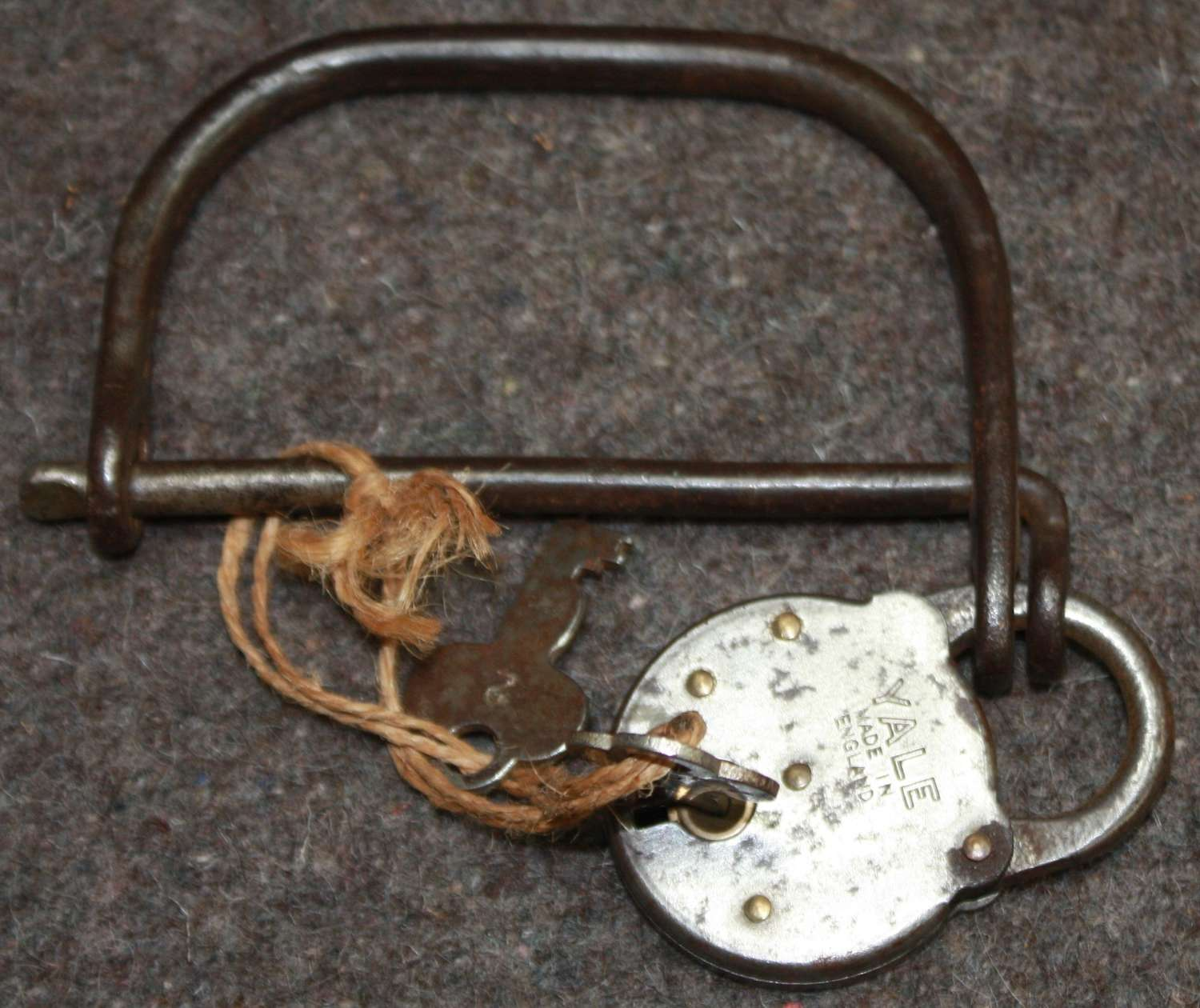 A WWII PERIOD KIT BAG RING AND LOCK