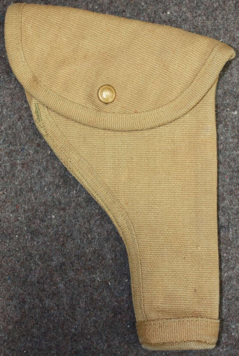 A WWII CANADIAN ROUNDED HOLSTER 1942 DATED