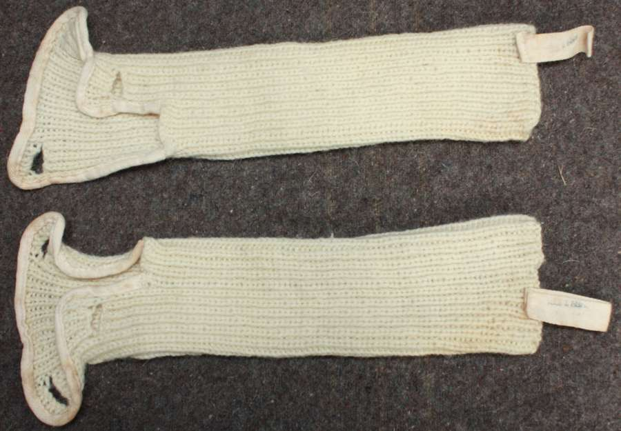 A WWII PERIOD OF ARM WARMERS WORN WITH THE SNOW EQUIPMENT
