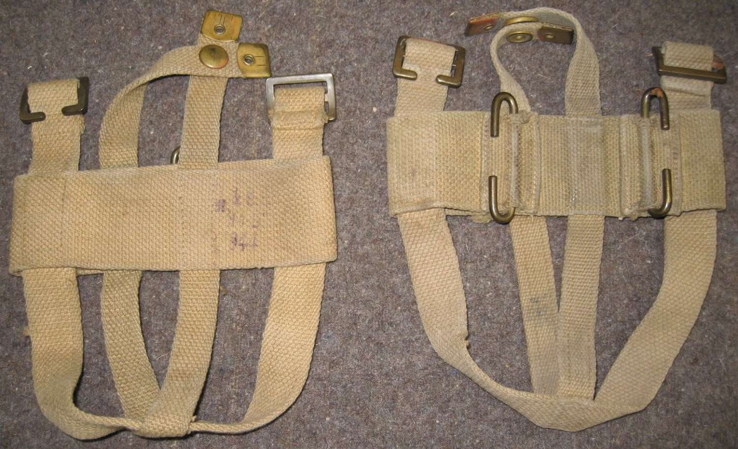 A WWII AUSTRALIAN MADE REAR ATTACHING WATER BOTTLE CRADLE