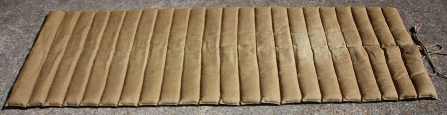 A WWII BRITISH ISSUE ROLL UP MATTRESS