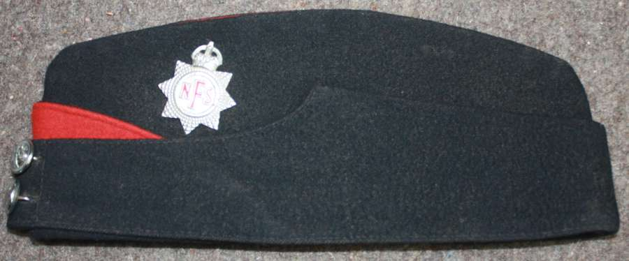 A WWII PERIOD NATIONAL FIRE SERVICE SIDE CAP NAMED TO A LADY