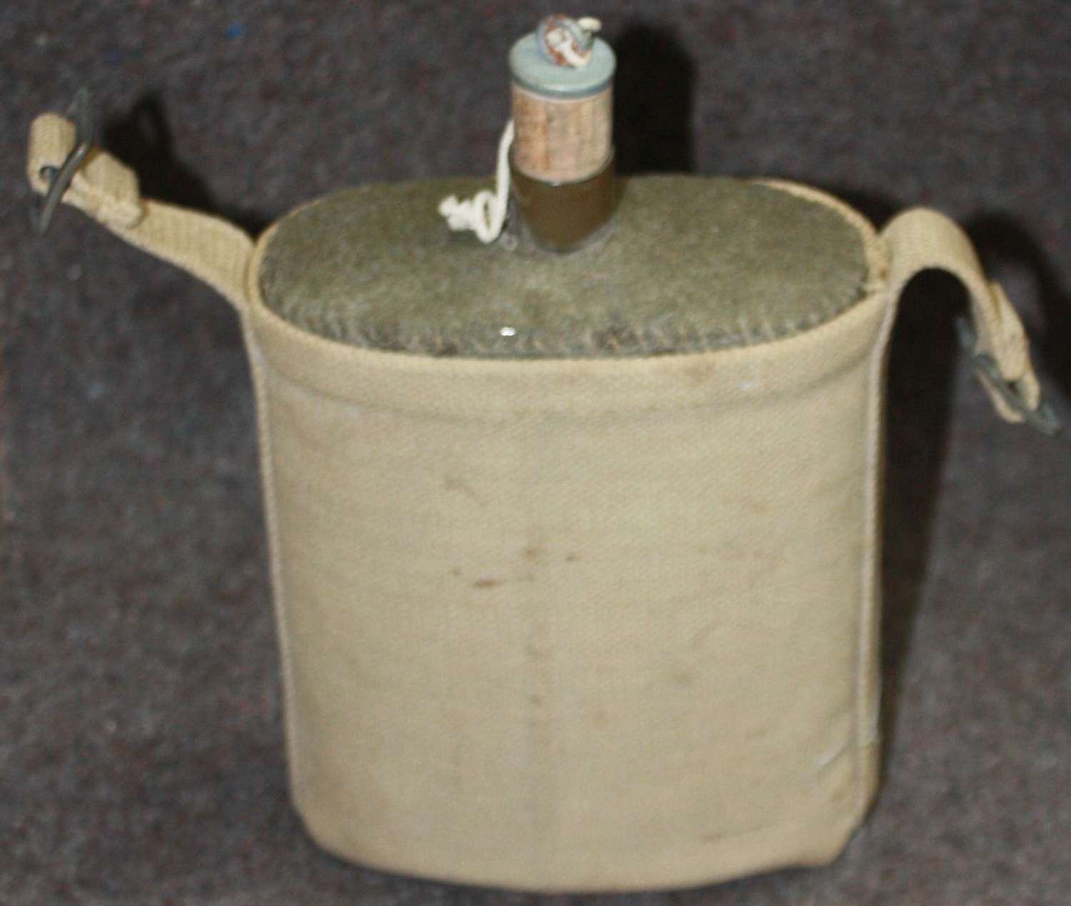A 1942 DATED WATER BOTTLE SLEEVE AND BOTTLE