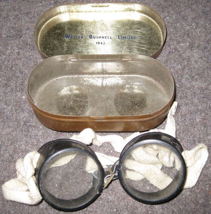 A PAIR OF WWII GOGGLES IN THERE TIN