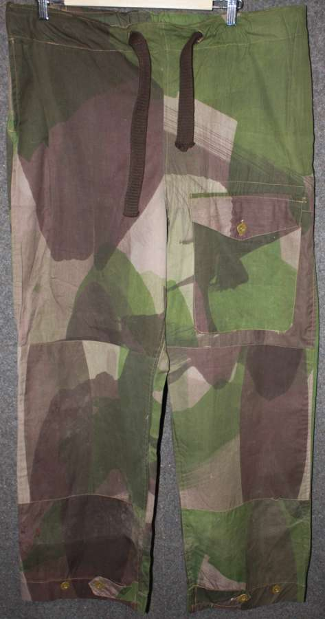 A PAIR OF WWII CAMO WINDPROOF TROUSERS SIZE 2 1943 DATED