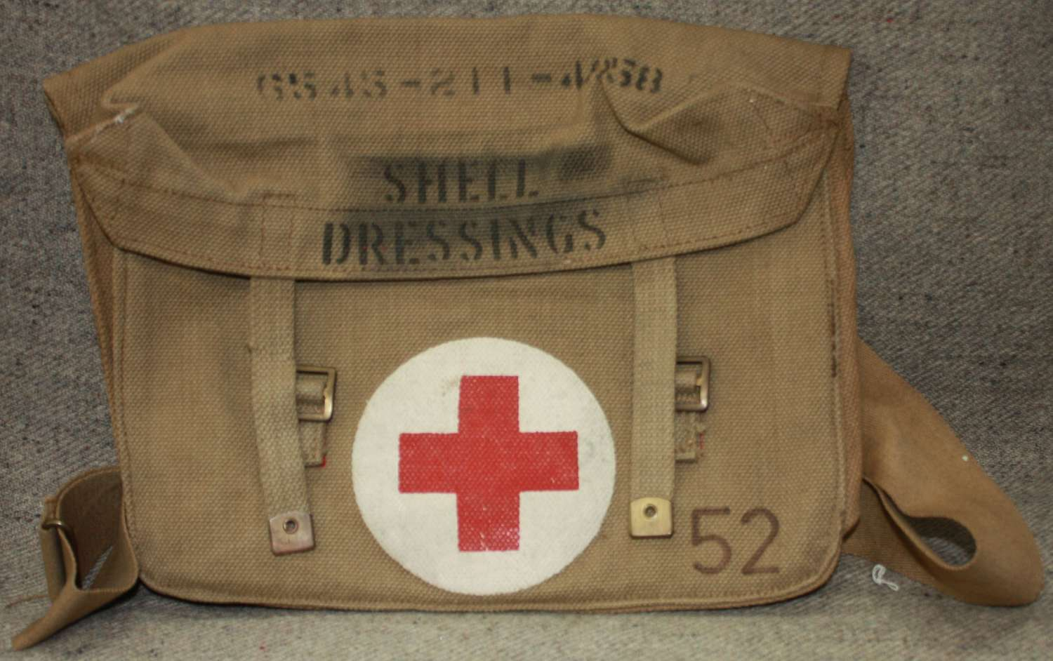 A WWII FIELD DRESSING BAG 1942 DATED