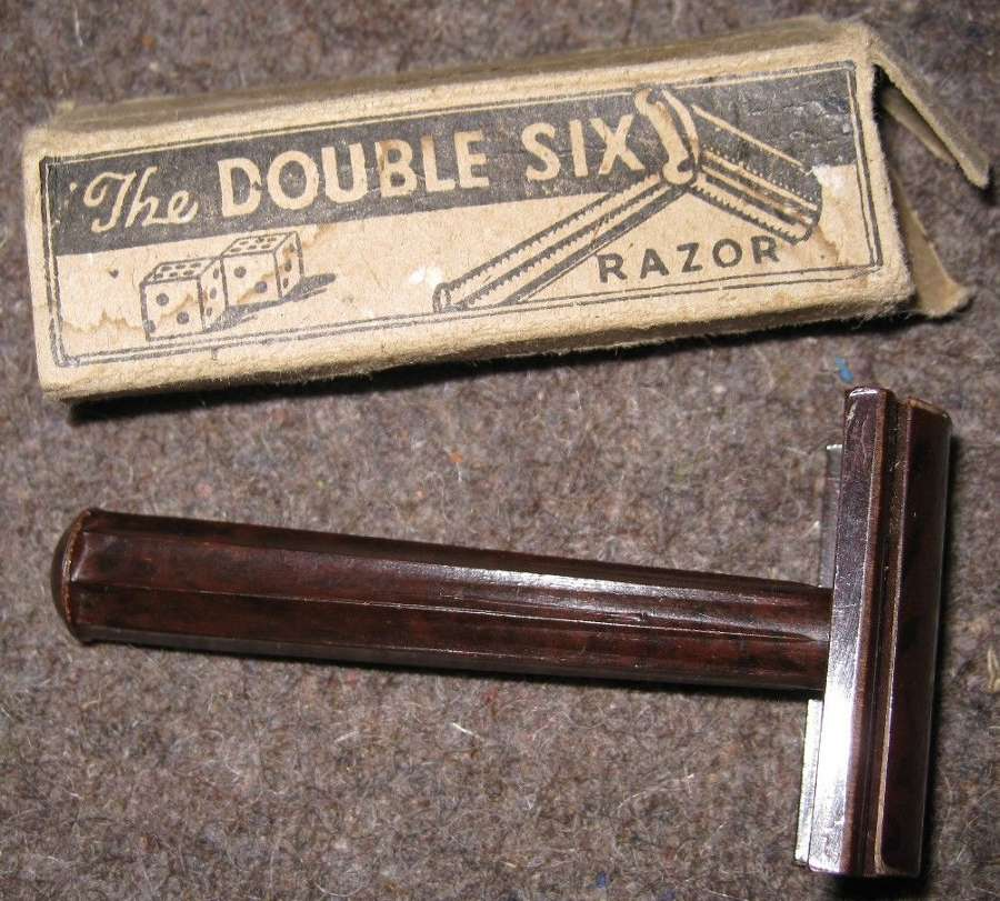 A 1944 DATED BOXED DOUBLE SIX RAZOR