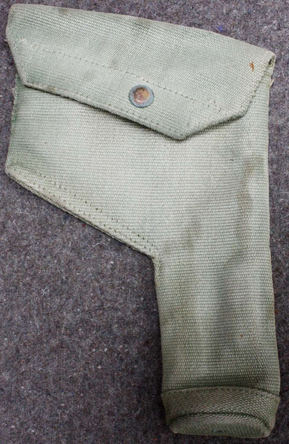A WWII 37 PATTERN WEBBING USED HOLSTER