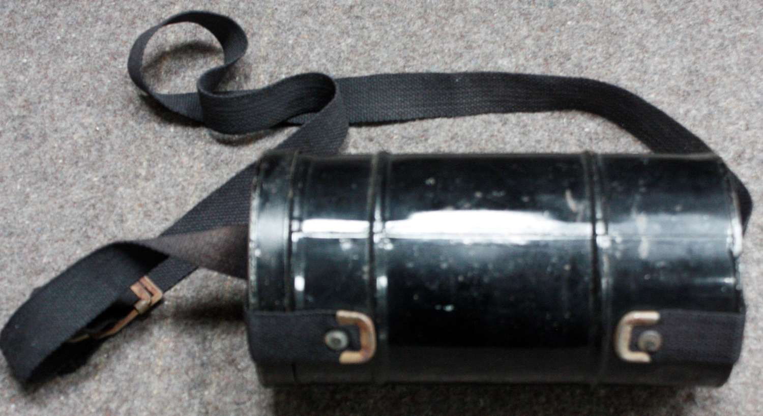 A WWII GAS MASK CONTAINER EMPTY