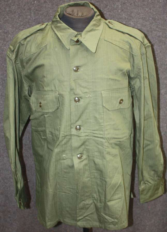 A VERY RARE MINT 1945 DATED US MADE BRITISH WAR AID JUNGLE SHIRT