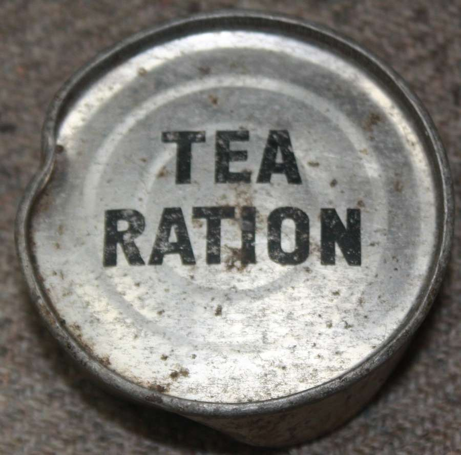 A WWII PERIOD SMALL ROUND TEA RATION TIN WHICH IS FULL