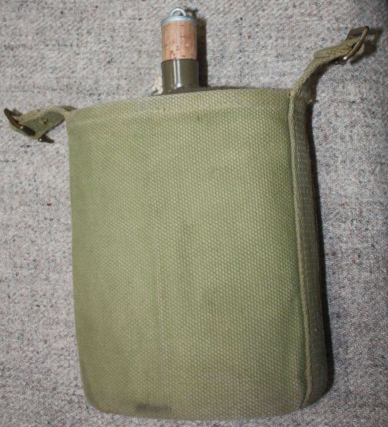 A WWII 37 PATTERN WATER BOTTLE AND CRADLE