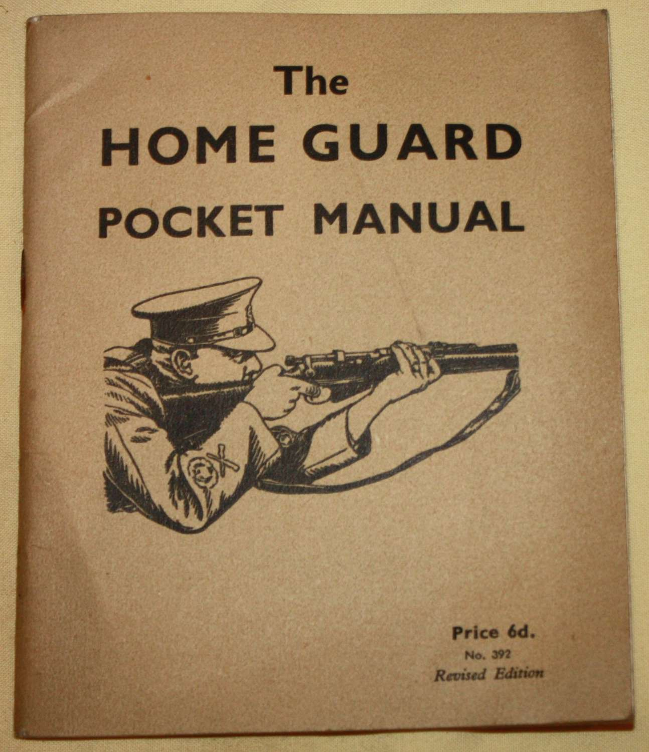 A GOOD WWII HOME GUARD POCKET BOOK AND HOME GUARD ARMBAND