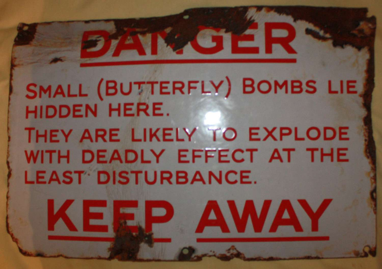 A FAIRLY GOOD USED EXAMPLE OF THE BUTTERFLY BOMB WARNING SIGN