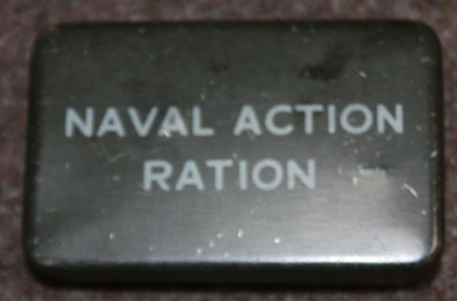 A GOOD WWII EMPTY NAVY ACTION RATION TIN