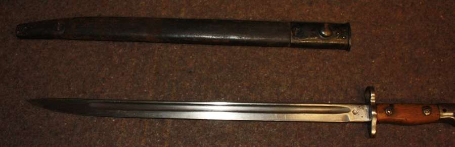A WILKISON 1907 PATTERN BAYONET WITH A WWII SCABBARDED