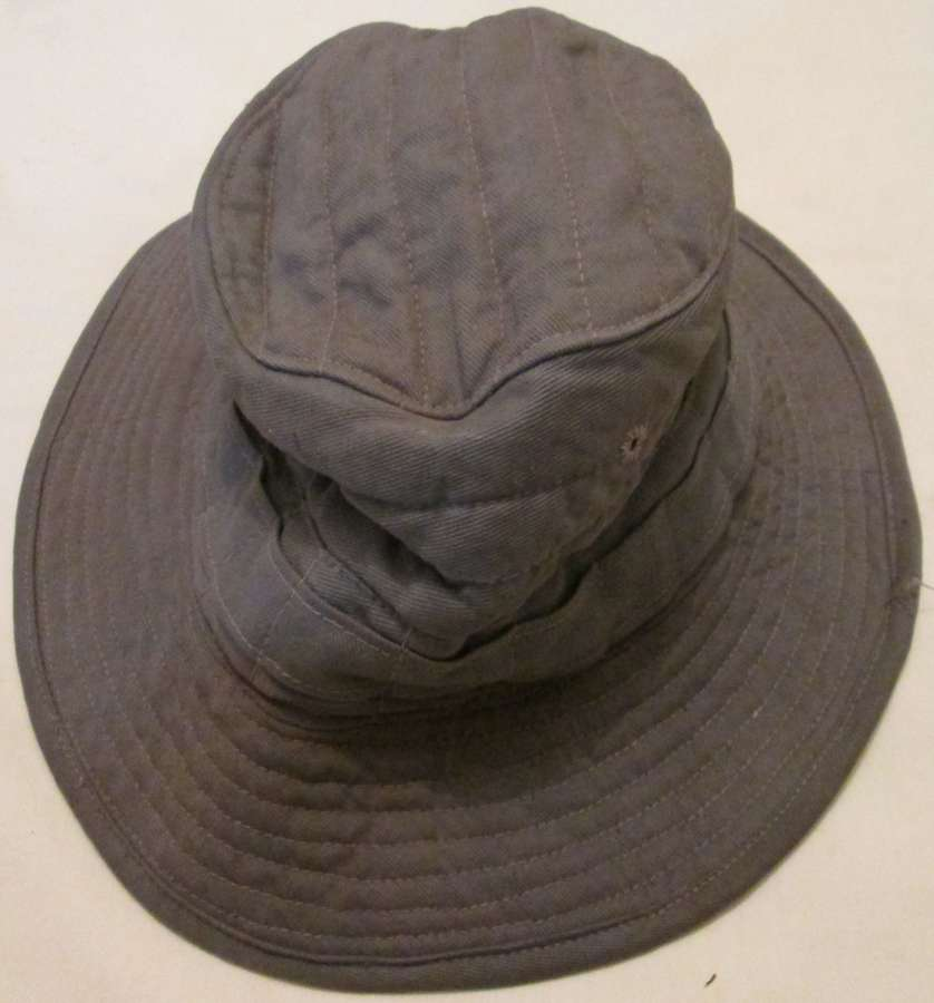 A GOOD USED EXAMPLE OF THE WWII INDINA MADE JUMGLE GREEN BUSH HAT