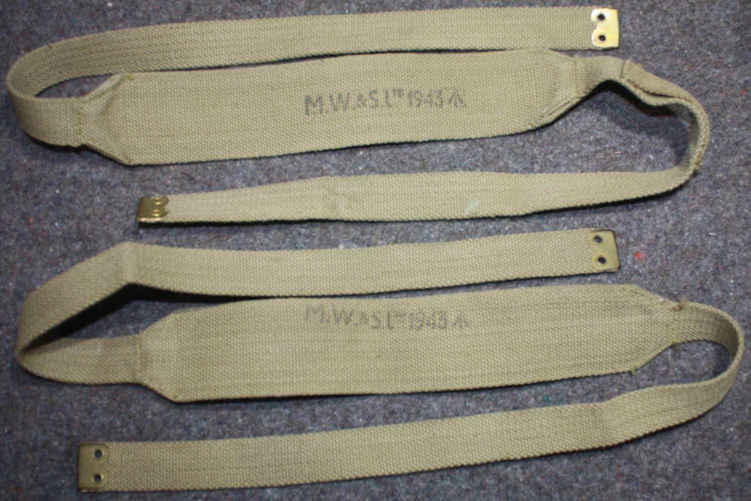 A GOOD MINT PAIR OF 37 PATTERN WEBBING SUSPENDERS MADE BY MWS 1943