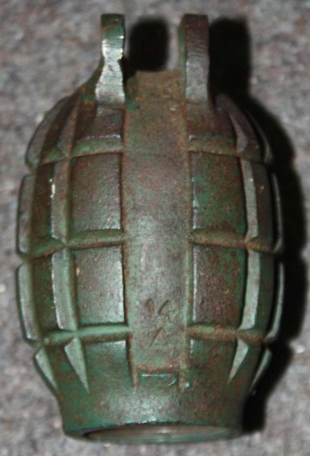 A MILLS BOMB WHICH HAS BEEN REPAIRED ( EAR )