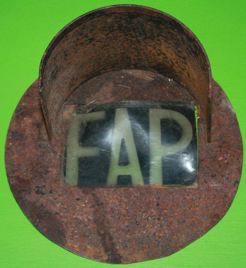 A RARE WWII FIST AID PARTY BLACK OUT HEAD LAMP COVER