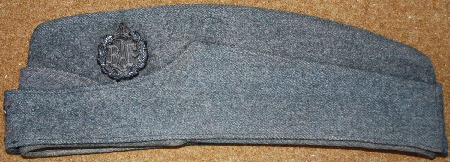 A WWII RAF SIDE CAP SIZE IS ABOUT A 7 1/4 PLASTIC CAP BADGE
