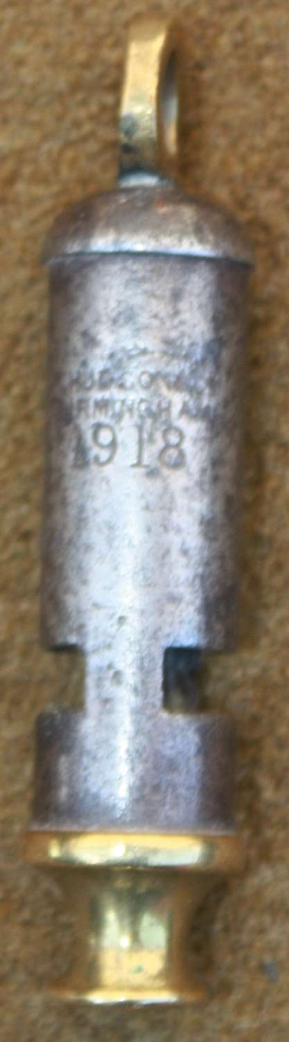 A 1918 DATED MILITARY ISSUE TUBE WHISTLE