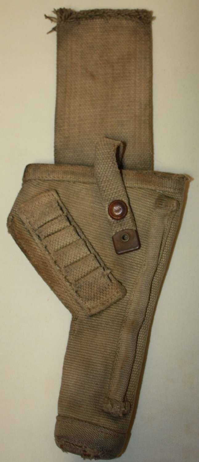 A BRITISH 1938 DATED TANK HOLSTER WITH THE TOP STRAP CUT DOWN
