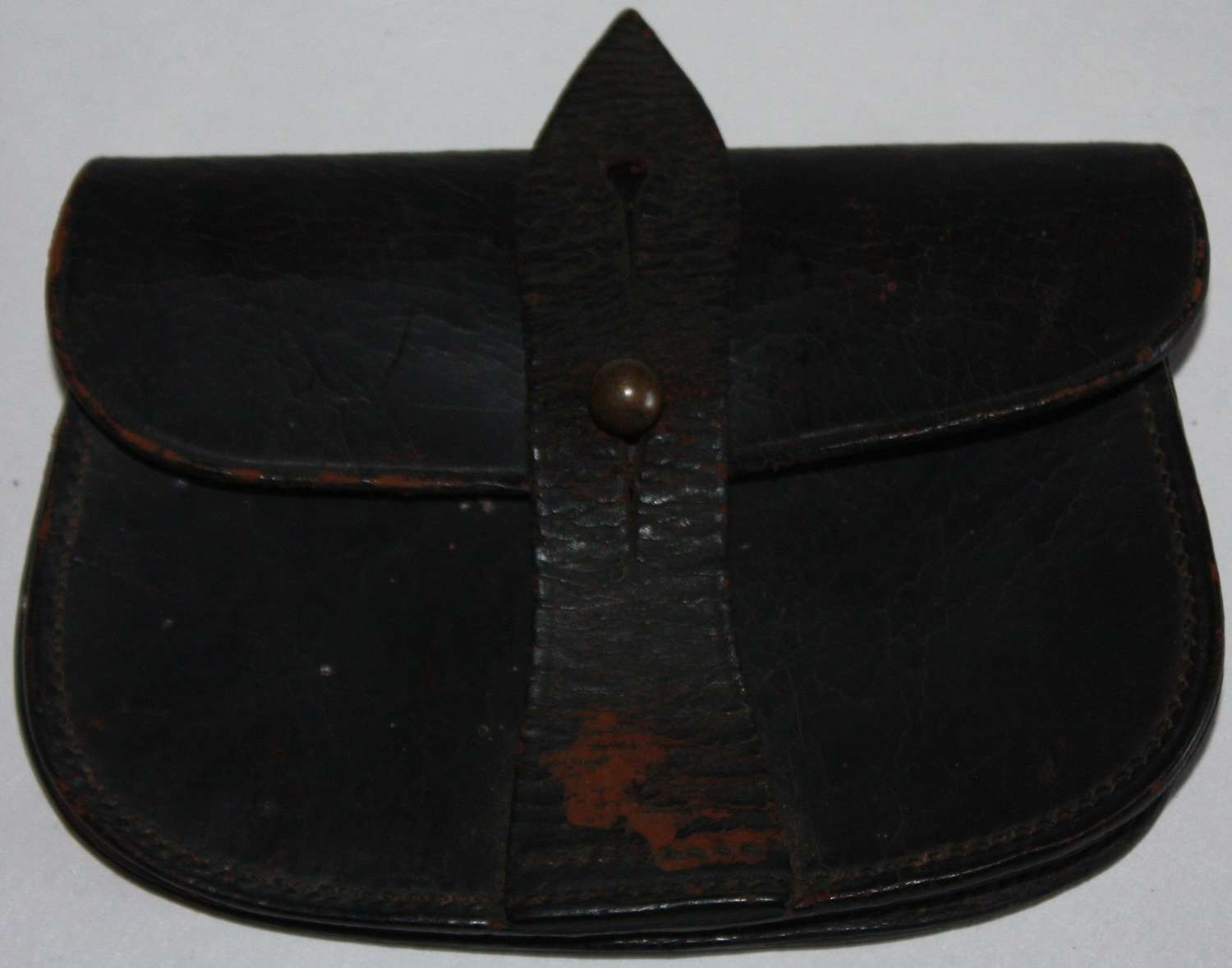 A GOOD USED POST WWI SAM BROWN PISTOL AMMO POUCH