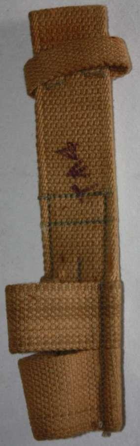A GOOD 1943 DATED INDINA ( BATA ) MADE 37 PATTERN WEBBING BAYONET FROG
