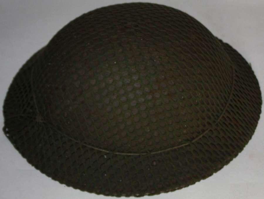 A GOOD USED EARLY WAR BRITISH HELMET NET