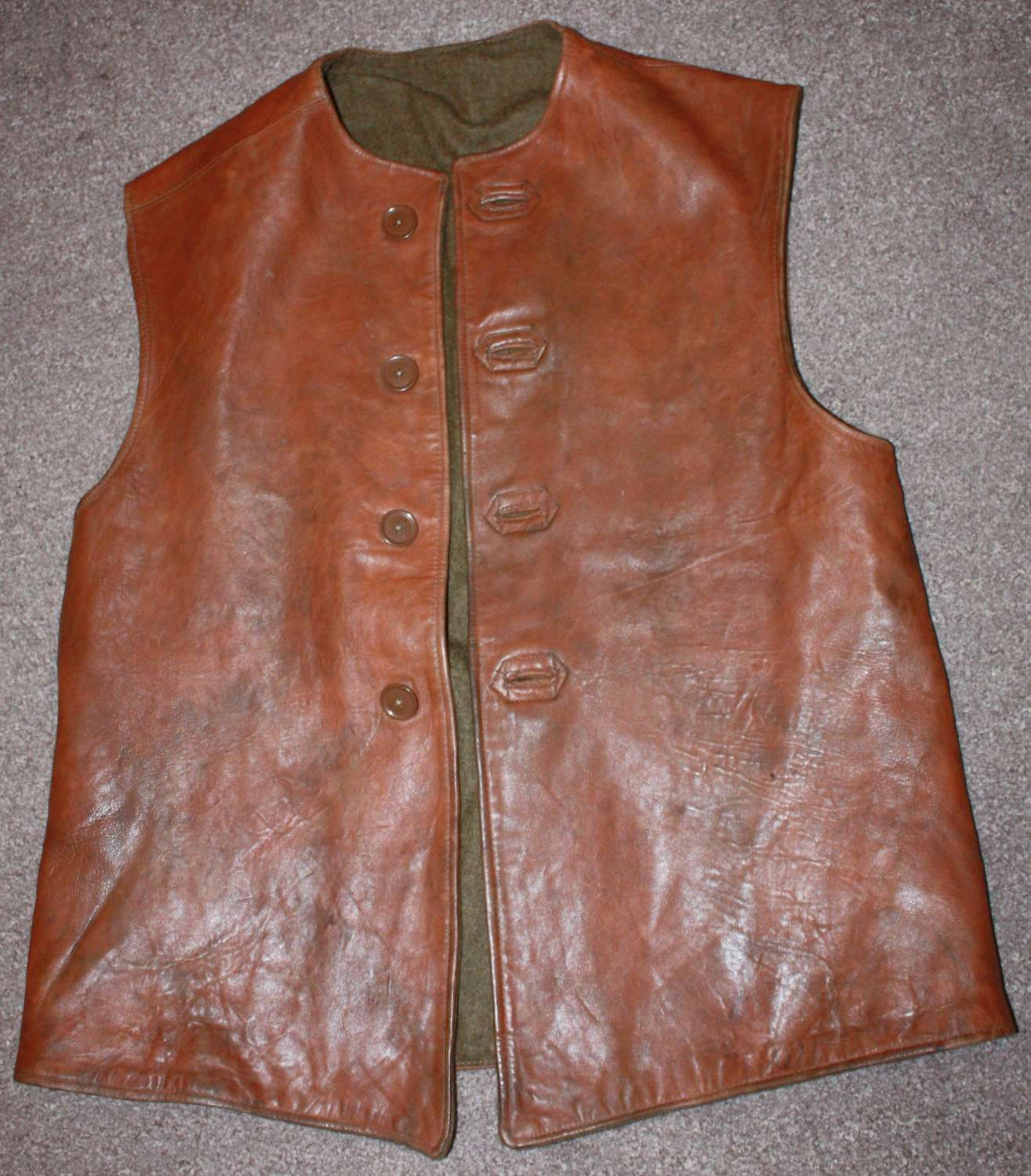 A GOOD 1945 DATED LEATHER JERKIN SIZE 2 CAMOUFLAGE  EXAMPLE