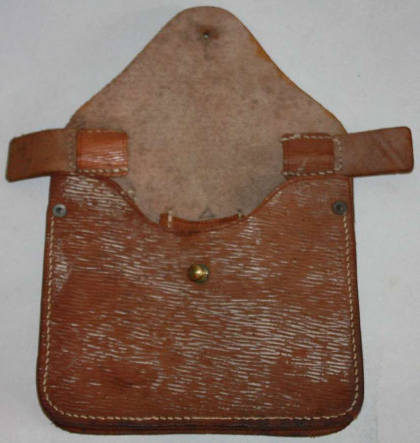 A 1942 DATED LEATHER FOLDING SAW POUCH