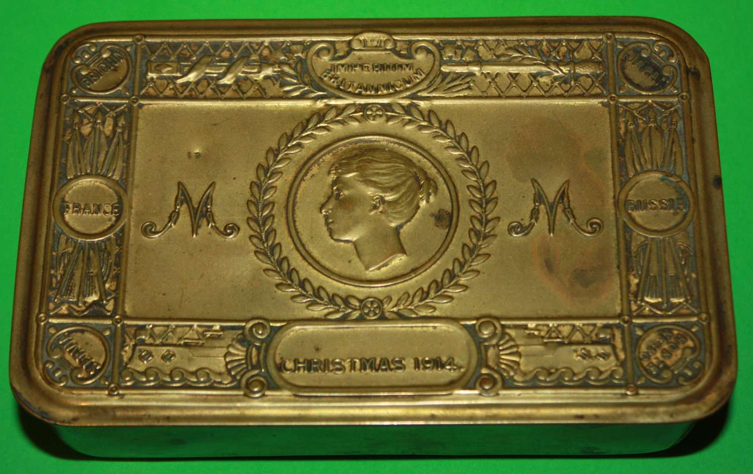 A GOOD USED WWI MARY TIN NO CRACKS TO THE CORNERS