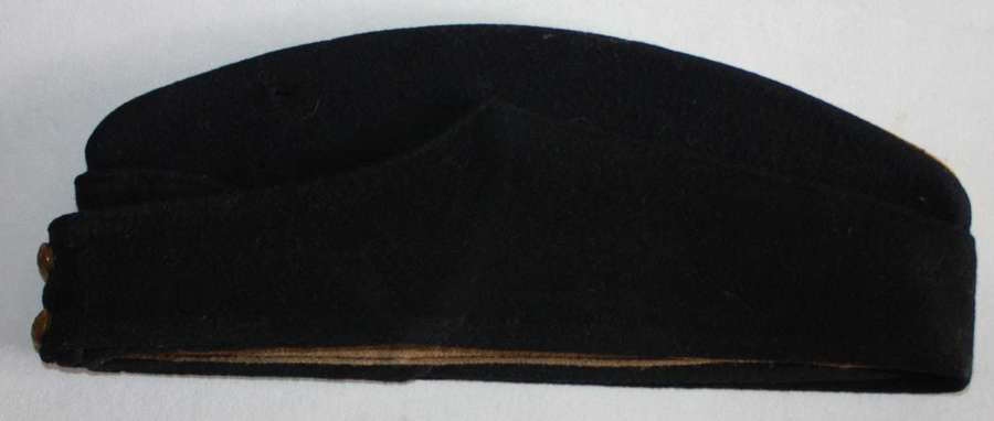 A GOOD WWII PERIOD BLACK SIDE CAP WITH YELLOW PIPING